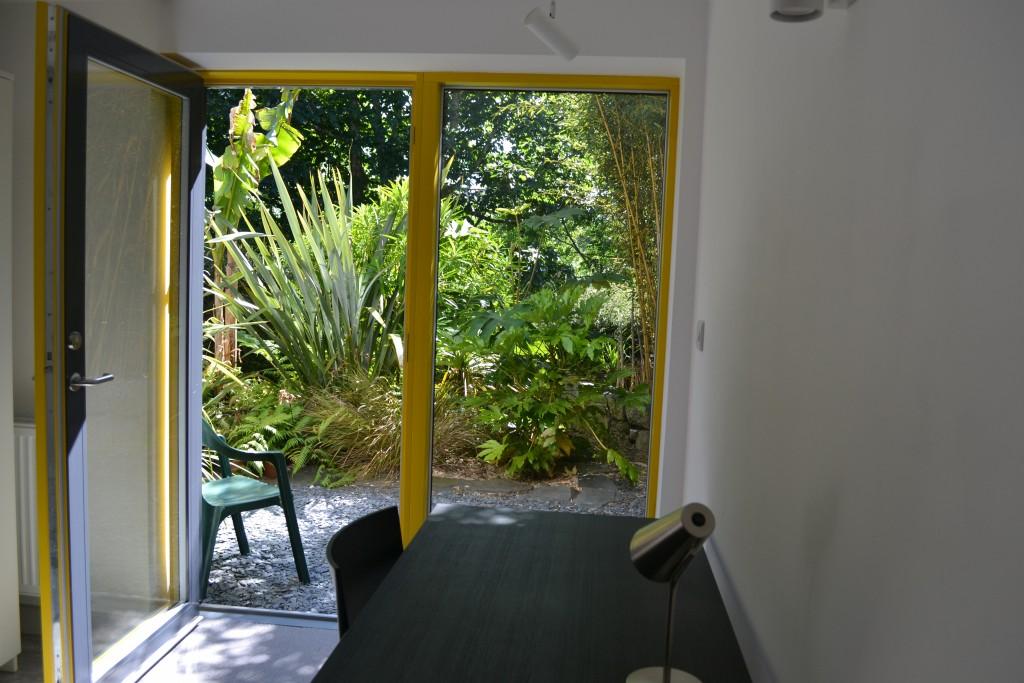 Study space overlooking tropical garden