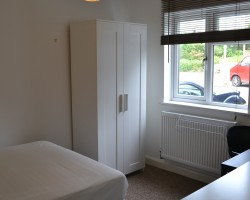 Two spacious light bedrooms with quality furniture